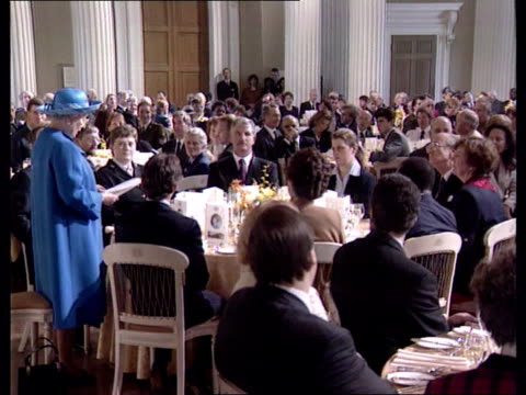 Golden wedding anniversary Whitehall Queen Elizabeth II standing speaking at luncheon as Shields sits on same table listening