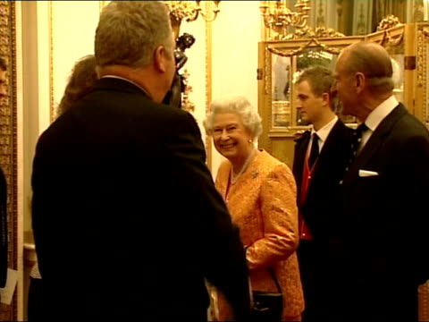 queen and prince philip greet mps and their partners / the reception england london buckingham palace int **some flash photography** queen elizabeth... - liam fox politician stock videos and b-roll footage
