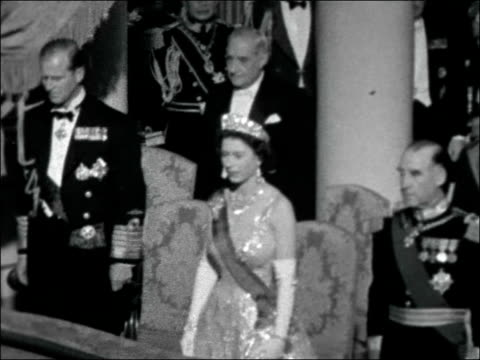 queen and prince philip state visit to portugal; portugal: lisbon: int interior of opera house showing crowded bones / s people in boxes / queen... - portugal stock-videos und b-roll-filmmaterial
