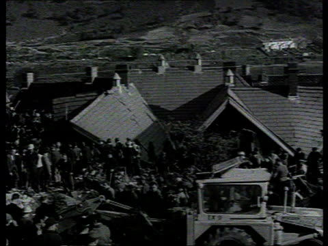 Queen and Prince Philip visit Aberfan LIB B/W People gathered around school buried after slag heap slipped down hill attempting rescue