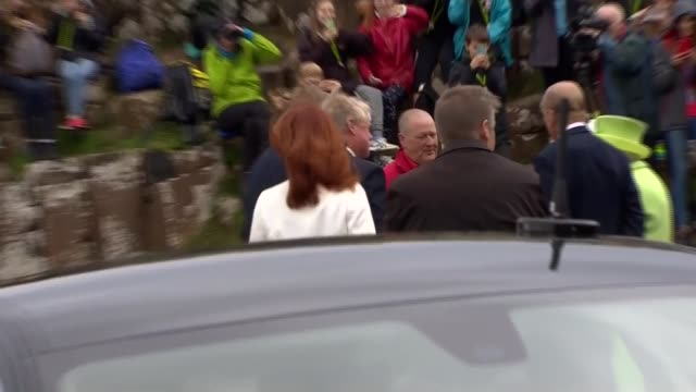 queen and prince philip visit giant's causeway northern ireland county antrim giant's causeway ext cars arriving as crowd awaits / queen elizabeth ii... - causeway stock videos & royalty-free footage