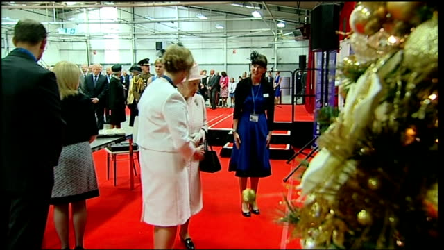 queen and prince philip visit international greetings company queen and prince philip looking at crackers queen handing partally made cracker to... - christmas cracker stock videos and b-roll footage
