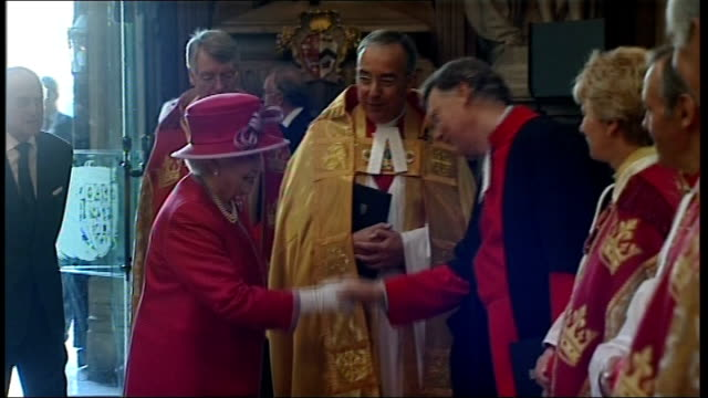 Queen and Prince Philip visit to Westminster Abbey and School ENGLAND London Westminster Abbey INT Clergy/choir procession through abbey Queen...