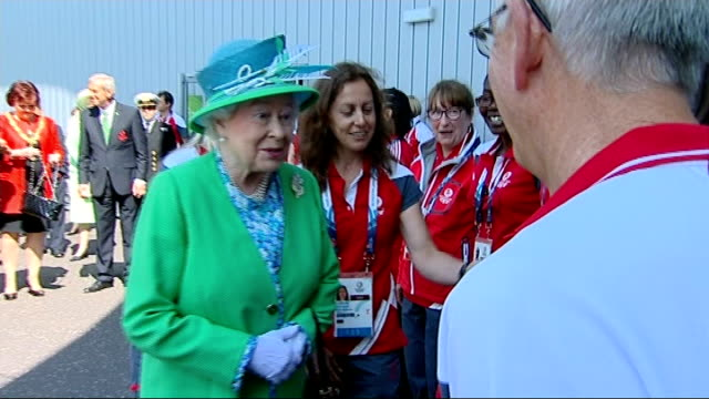 queen and prince philip visit venues and meet athletes; ext various shots of queen and philip meeting hockey players including australian hockey team... - torschuss stock-videos und b-roll-filmmaterial