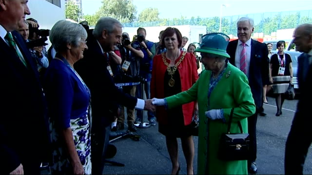 Queen and Prince Philip visit venues and meet athletes SCOTLAND Glasgow EXT Royal Bentley arriving / Queen Elizabeth II and Prince Philip Duke of...