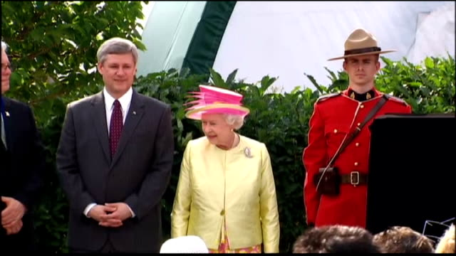queen and prince philip visit winnipeg; queen along and standing on stage / queen next to stephen harper and canadian mountie / various of people in... - human stage stock videos & royalty-free footage