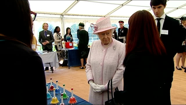queen and prince philip wales visit uwc atlantic college more of queen and duke being shown exhibits / students ringing bells on music therapy table... - music therapy stock videos & royalty-free footage