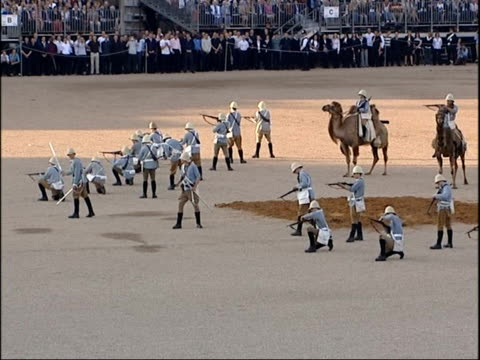 Queen and Prince Philip watch Household Cavalry Pagaent Procession of camels into arena for a recreation of how the Heavy Camel Regiment would have...