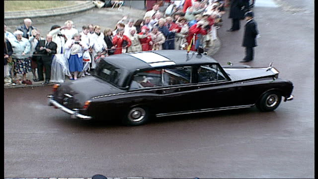 queen and royal family attend order of the garter ceremony england windsor windsor castle the queen seen waving from moving rolls royce crowds... - rolls royce videos stock videos & royalty-free footage