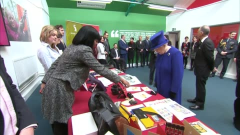 queen and the prince of wales celebrate 40 years of the prince's trust.; queen inspects beekeeper hive/ charles looks at books/ queen shaking hands /... - プリンスズトラスト点の映像素材/bロール