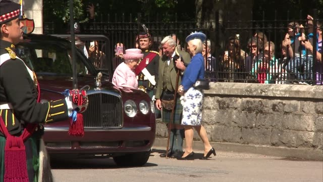 Balmoral EXT Pipers onto parade ground and troops along in formation with Shetland pony Cruachan 1V / Queen Elizabeth II arriving in car and...