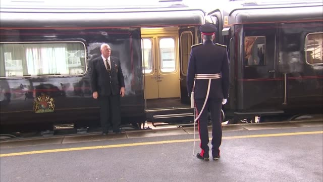 queen arrives at plymouth station and attends decommissioning ceremony for hms ocean england devon plymouth plymouth railway station ext electronic... - queen royal person stock videos & royalty-free footage