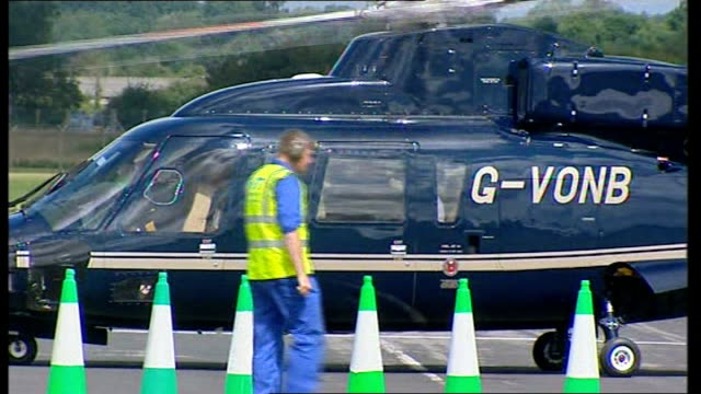 queen arrives at raf fairford queen elizabeth and prince philip out of helicopter and along with raf dignitaries towards marquee - raf fairford stock videos and b-roll footage