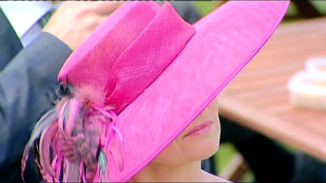 queen at ascot opening day gvs women in fancy hats men in top hats / blue hats / pink hat with matching outfit / another pink hat / woman fixes the... - hat stock videos & royalty-free footage
