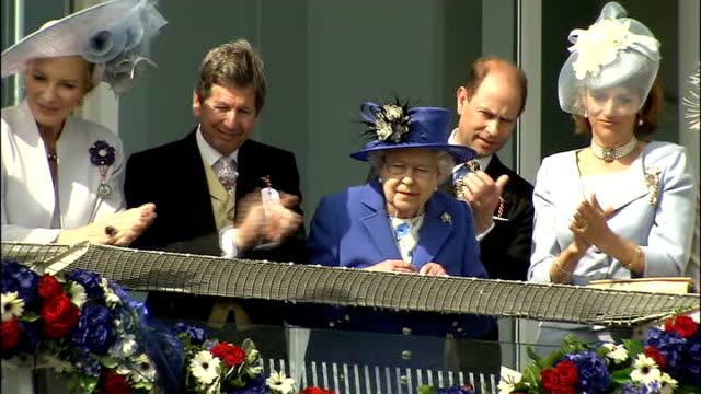 Queen at The Derby More of Queen on balcony / general view of Queen and royal party back into building