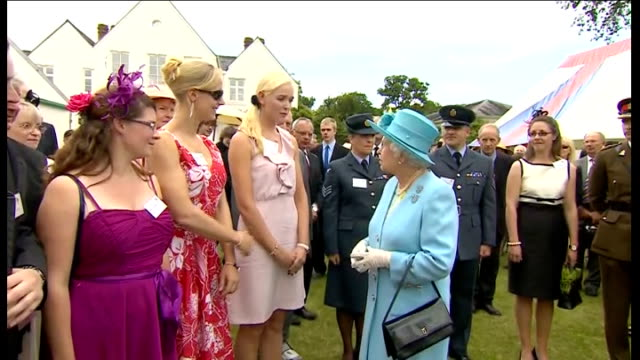 queen attending river pageant in henley; more of queen along with crowd applauding sot / various shots of queen along chatting to people including... - terry wogan stock videos & royalty-free footage