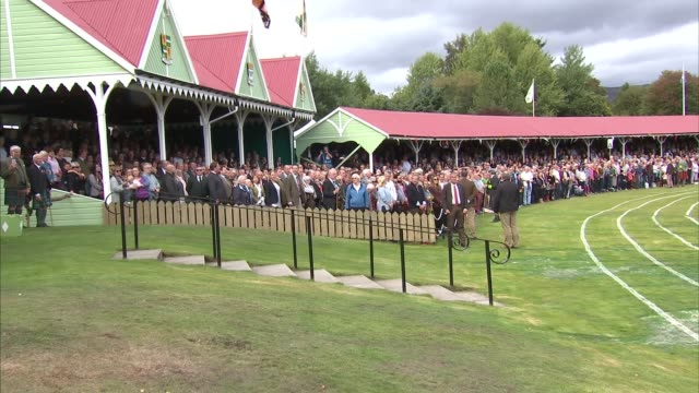 queen attends braemar gathering and opens new highland games pavilion scotland aberdeenshire braemar national anthem sung / queen elizabeth ii and... - highland games stock videos & royalty-free footage