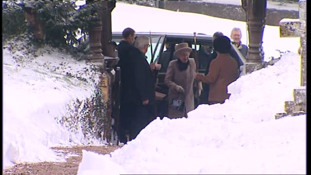 Queen attends church on eve of 60th anniversary of her accession to the throne ENGLAND Norfolk Sandringham Police officer outside church / People...