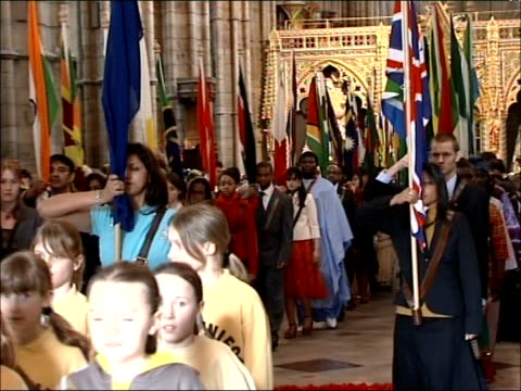queen attends commonwealth day service at westminster abbey; ext general view westminster abbey exterior int procession of brownie girl guides and... - religious dress stock videos & royalty-free footage