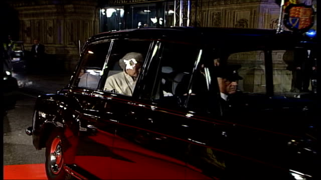 queen attends 'die another day' premiere at royal albert hall; england: london: royal albert hall: car along zoom to queen elizabeth ii & duke of... - 007 ダイ・アナザー・デイ点の映像素材/bロール