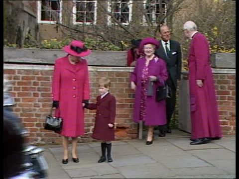 queen attends easter services; england: windsor queen elizabeth ii holding prince harry's hand out of church gate followed by queen mother , prince... - エリザベス・ボーズ=ライアン点の映像素材/bロール