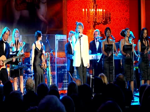 queen attends event marking merger of the rnib and the nlb: event scenes; rod stewart performing 'blue moon sot - rod stewart stock-videos und b-roll-filmmaterial