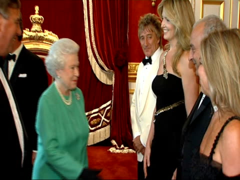 queen attends event marking merger of the rnib and the nlb: event scenes; england: london: st james' palace: int singer rod stewart and his fiancee... - rod stewart stock-videos und b-roll-filmmaterial