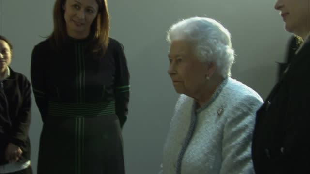 Queen attends London Fashion Week ENGLAND London PHOTOGRAPHY** **Music heard intermittently SOT** People waiting / Queen Elizabeth II and Caroline...