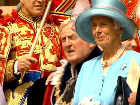 queen attends order of the garter procession at st george's chapel sir john major standing on steps with others / baroness thatcher along getting... - ノーマ メジャー点の映像素材/bロール