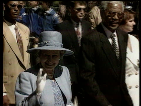 queen attends parliament meets nelson mandela itn south africa cape town tms queen next mandela along thru crowd pan - nelson mandela stock videos and b-roll footage