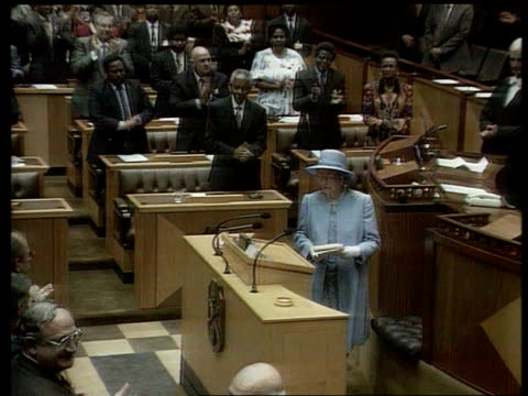 queen attends parliament meets nelson mandela itn south africa cape town parliament building tls queen along to podium tcms queen elizabeth ii speech... - the queen stock videos and b-roll footage