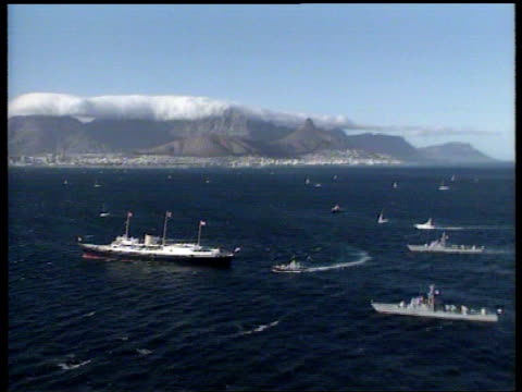 Queen attends parliament Meets Nelson Mandela ITN SOUTH AFRICA Cape Town AIRV Royal yacht 'Britannia' along near Cape Town harbour LS Naval officer...
