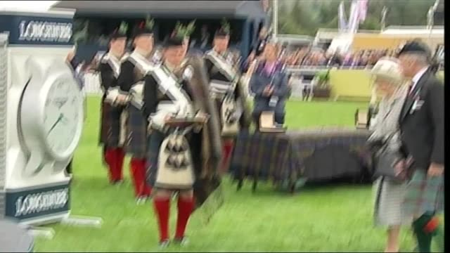 queen attends perthshire horse show scotland perthshire blair castle ext queen elizabeth ii along pitch / horses lined up at show / queen along to... - perthshire stock videos & royalty-free footage