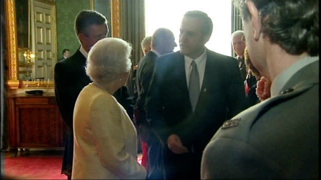 queen attends reception for royal marines childrens charity; england: london: st james's palace: int ** warning some flash photography ** queen... - royal marines stock videos & royalty-free footage