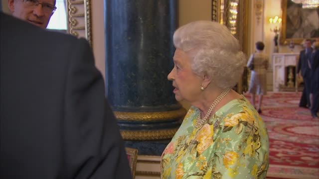 queen attends reception to celebrate the queen's award for enterprise england london buckingham palace photography*** queen elizabeth ii and prince... - greeting stock videos & royalty-free footage