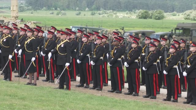 queen attends royal artillery event various shots soldiers lined up for parade - teilnehmen stock-videos und b-roll-filmmaterial