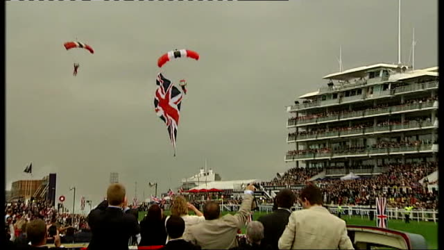 queen attends the derby at start of diamond jubilee celebrations members of the red devls parachute display team parachuting onto racecourse with... - stilts stock videos and b-roll footage