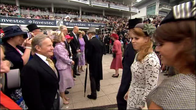 Queen attends The Derby at start of Diamond Jubilee celebrations Queen Prince Philip Duke of York and Princess Beatrice and Eugenie shaking hands...
