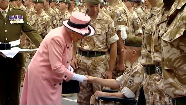 queen attends the drumhead service of thanksgiving; england: chester: chester racecourse: ext queen elizabeth ii presenting medal to fusilier shaun... - 英国チェスター点の映像素材/bロール