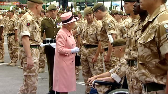 queen attends the drumhead service of thanksgiving queen steps down from dais various side shots of queen presenting medals to troops and chatting to... - regiment stock videos & royalty-free footage