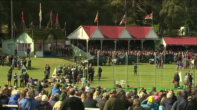 queen attends the highland games queen's arrival seen from another angle and more of the royal party sat in their pavilion - highland games stock videos & royalty-free footage