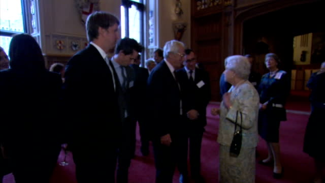 queen awarded honorary bafta at bfi event; queen along in reception chatting to people including robert hardy and eddie redmayne / penelope keith and... - penelope keith stock-videos und b-roll-filmmaterial