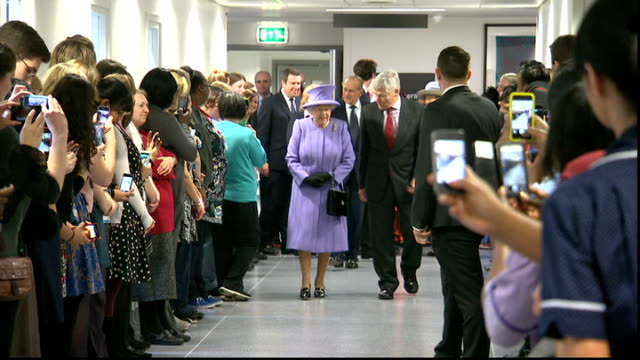 Queen cancels appointments due to stomach bug File / 2722013 East London Whitechapel Royal London Hospital INT Queen Elizabeth II along corridor past...