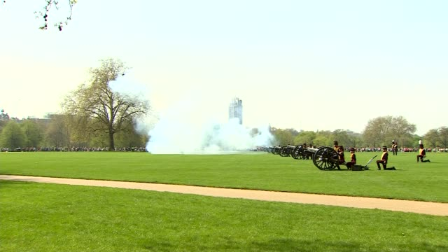 queen celebrates 92nd birthday: hyde park gun salute; england: london: hyde park: ext cavalry charge along with cannons / various shots 41 gun salute... - queen's birthday stock videos & royalty-free footage