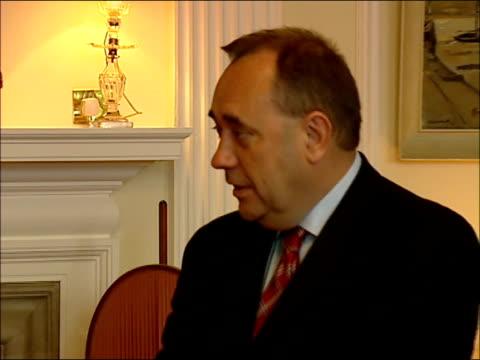 edinburgh int queen elizabeth ii standing chatting with new scottish first minister alex salmond sot - alex salmond stock videos & royalty-free footage
