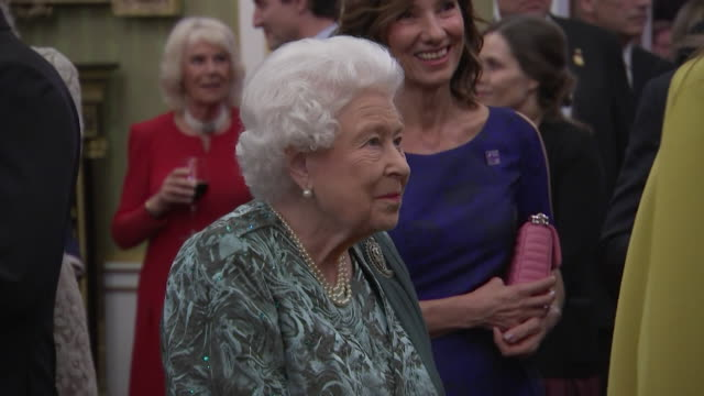 queen chats with female nato leaders at buckingham palace reception during nato summit, including angela merkel, erna solberg, sophie wilmes and... - happiness stock videos & royalty-free footage
