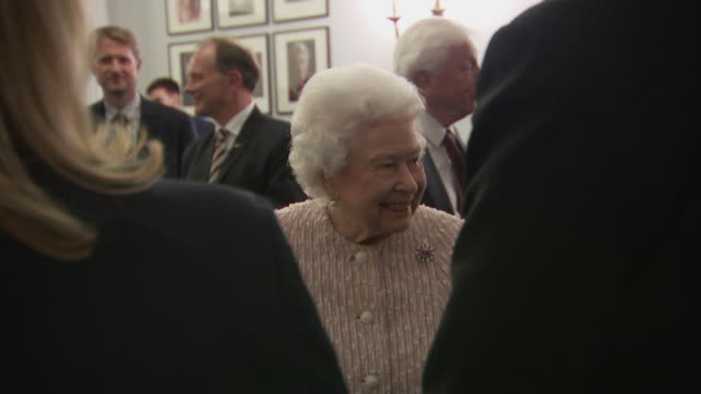 queen chats with guests as she attends chatham house prize event london - ヨーク公 アンドルー王子点の映像素材/bロール