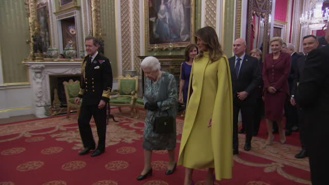 queen chats with us first lady melania trump at buckingham palace reception during nato summit - talking stock videos & royalty-free footage