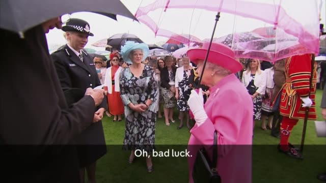 queen criticises chinese officials for being 'rude'; ext earl peel introduces lucy d'orsi to queen elizabeth sot - can i present commander lucy... - disrespect stock videos & royalty-free footage