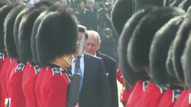 queen criticises chinese officials for being 'rude'; r20101504 / horse guards parade: various shots prince philip and xi jinping along line reviewing... - disrespect stock videos & royalty-free footage